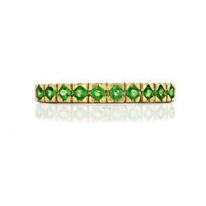 Кольцо с зелеными гранатами покрытое золотом